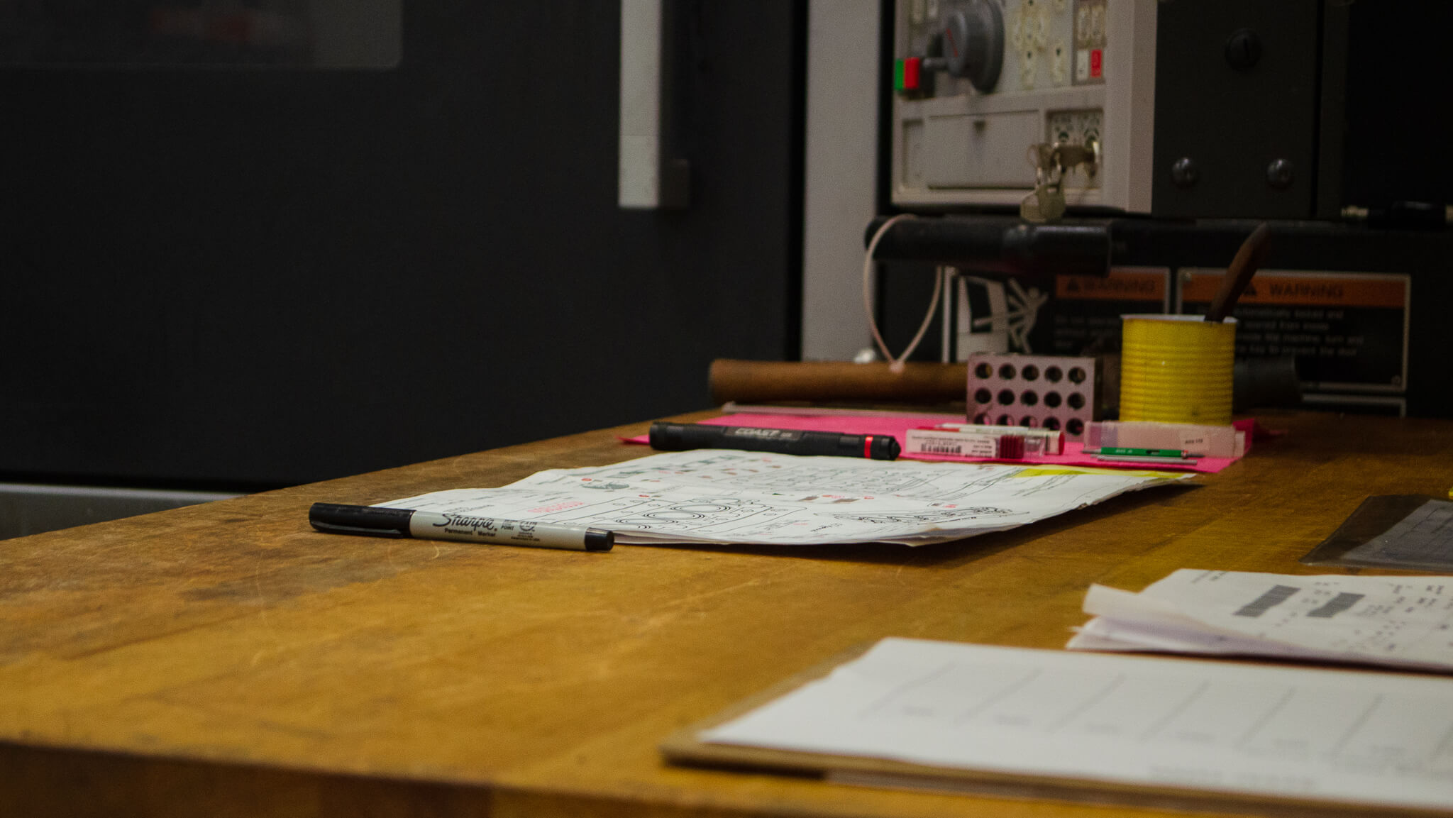 paper inspection planning, papers and markers on a desk